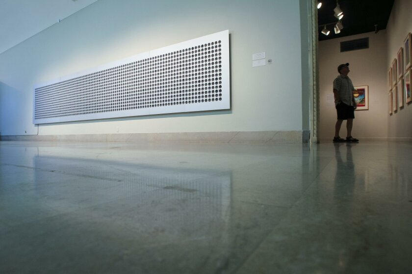 """""""Microtonal Wall,"""" 2011, by Tristan Perich nearly fills up Gallery 1 at the San Diego Museum of Art in Balboa Park. Perich has assembled 1,500 small speakers into an aluminum frame. He evenly divides four octaves into 1,500 microtones, so each speaker has a slightly different pitch."""