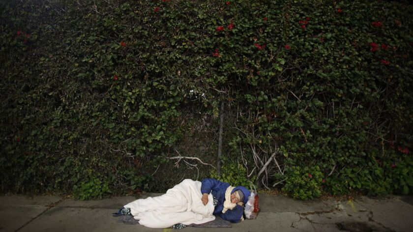 Rachel Phillips, a homeless, mentally ill woman who is approximately 67 years old, sleeps on the sidewalk in Hollywood on Feb. 17, 2017.