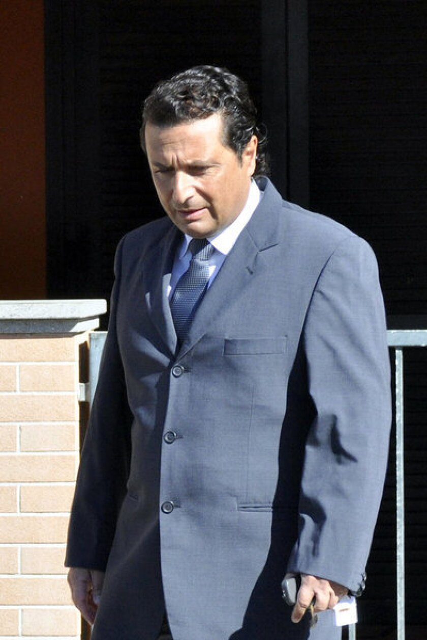 Francesco Schettino, the former captain of the Costa Concordia luxury cruise ship, leaves his house in the Italian city of Grosseto last week to attend a closed-door hearing.