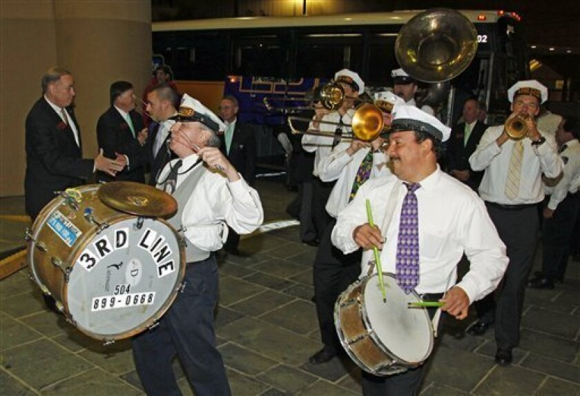 The Third Line Brass Band greets LSU football players as they arrive in New Orleans on Wednesday, Jan. 4, 2012. LSU is scheduled to play Alabama in the BCS Championship NCAA college football game on Jan. 9. (AP Photo/Bill Haber)