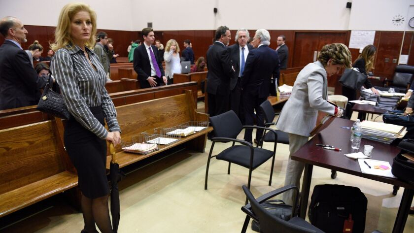 Summer Zervos, left, appears at a New York state court hearing Tuesday in her defamation suit against President Trump.