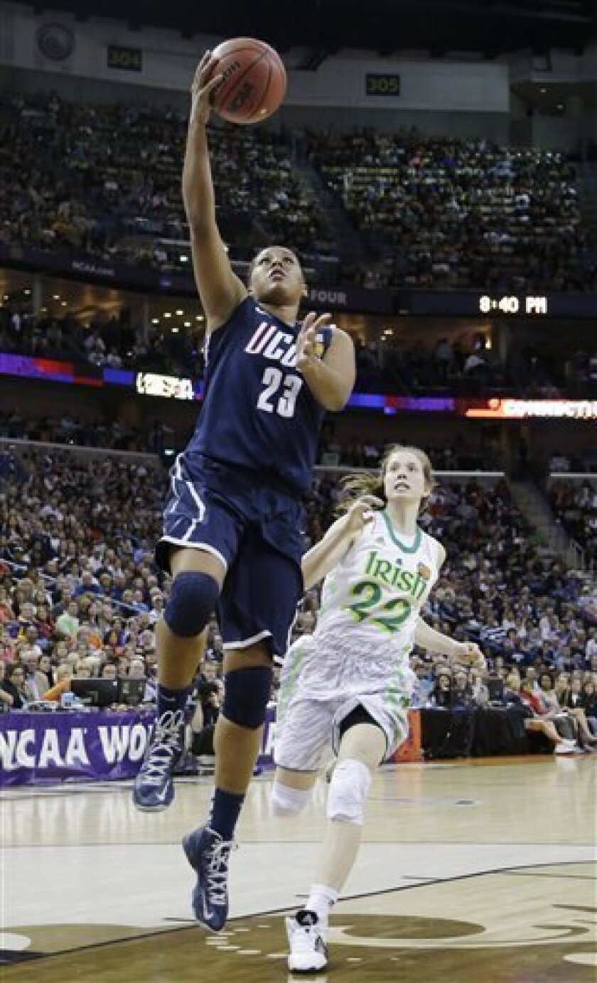 Connecticut forward Kaleena Mosqueda-Lewis (23) goes up for a shot against Notre Dame guard Madison Cable (22) in the first half of the women's NCAA Final Four college basketball tournament semifinal, Sunday, April 7, 2013, in New Orleans. (AP Photo/Gerald Herbert)