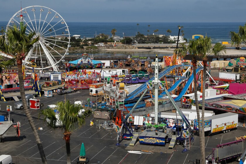 Crews disassemble rides on Wednesday after the last day of the San Diego County Fair. (Eduardo Contreras/Union-Tribune)