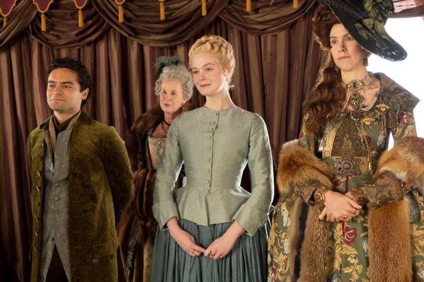 "Sebastian De Souza, left, Elle Fanning and Belinda Bromilow in Tony McNamara's historical satire ""The Great."""