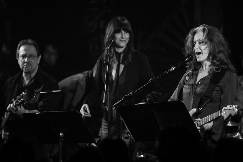 Bonnie Raitt, right, is joined by singer Nicki Bluhm and guitarist Danny Grenier at Saturday's Americana Music Assn. all-star salute to Eagles founding member Glenn Frey, at the Troubadour in West Hollywood.