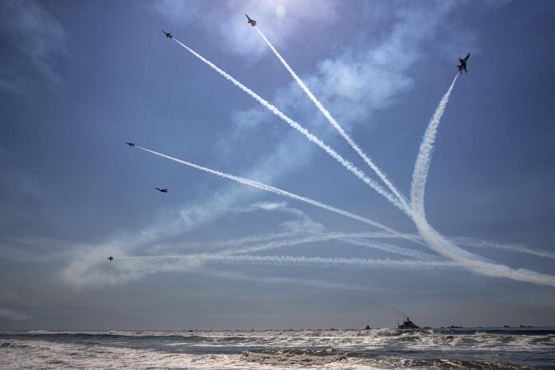 U.S. Air Force Thunderbirds break formation over the ocean