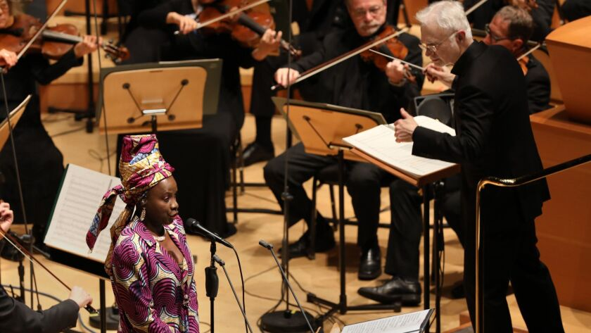 """Angèlique Kidjo is the soloist in the world premiere of Philip Glass' Symphony No. 12 (""""Lodger"""") given by the Los Angeles Philharmonic and conducted by John Adams on Thursday night at Walt Disney Concert Hall."""