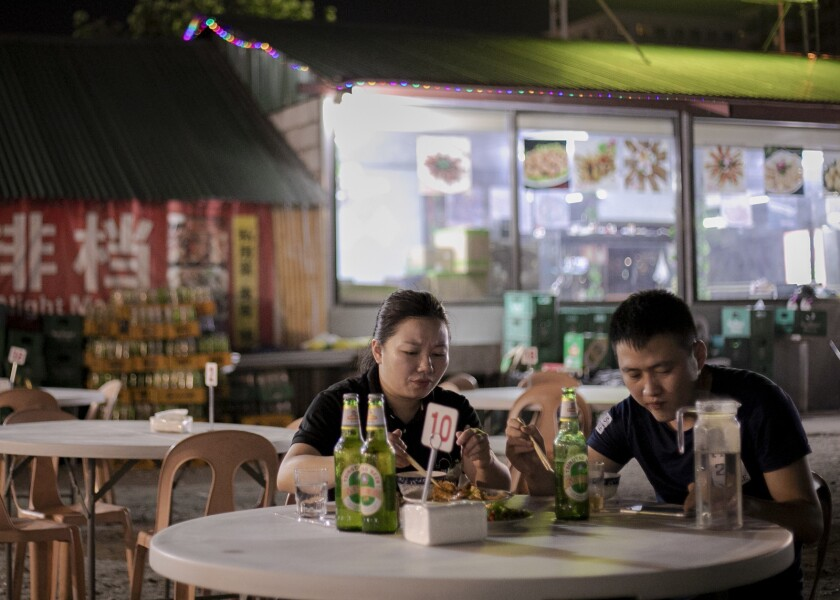 Chinese cutomers dine in a Chinese night market in Pasay City, Philippines, May 7, 2019.