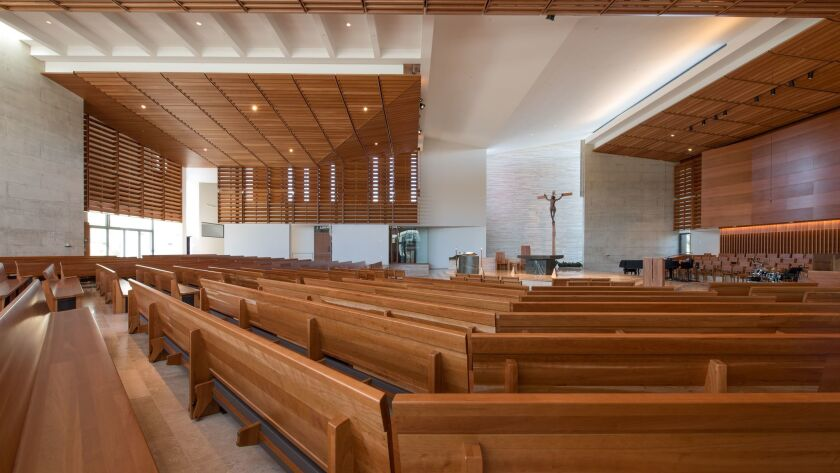 St. Thomas More Catholic Church's light-filled interior illuminates a contemporary layout highlighted by some surprising artistic and sculptural features. inside.