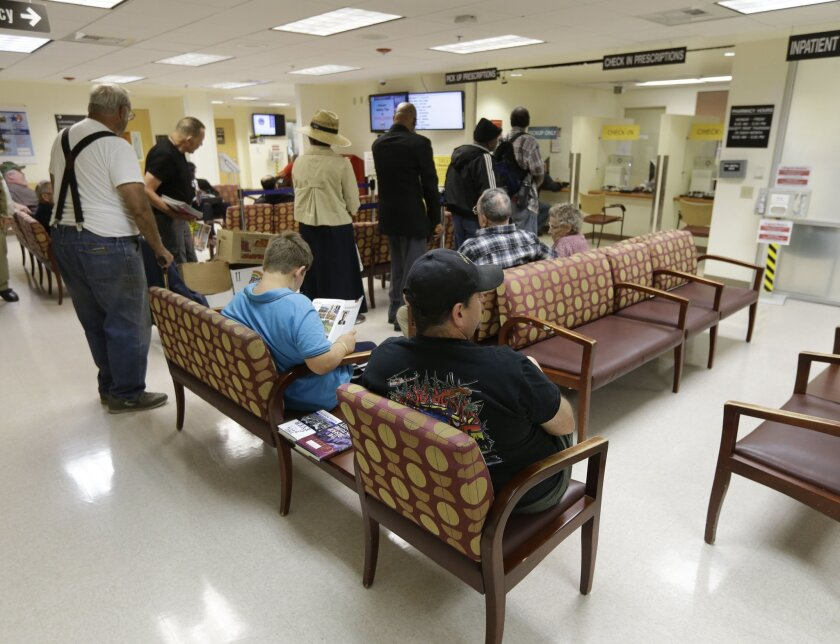 People line up to get prescriptions filled at the pharmacy in the Sacramento Veterans Affairs Medical Center in Rancho Cordova April 2.