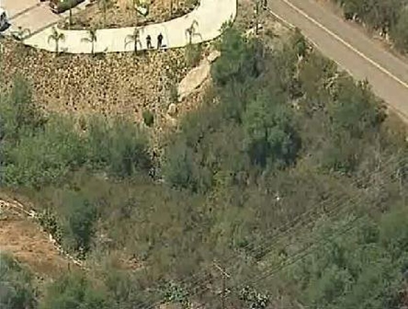 Video from Sky 10 shows authorities preparing to extract a body found in the ravine.