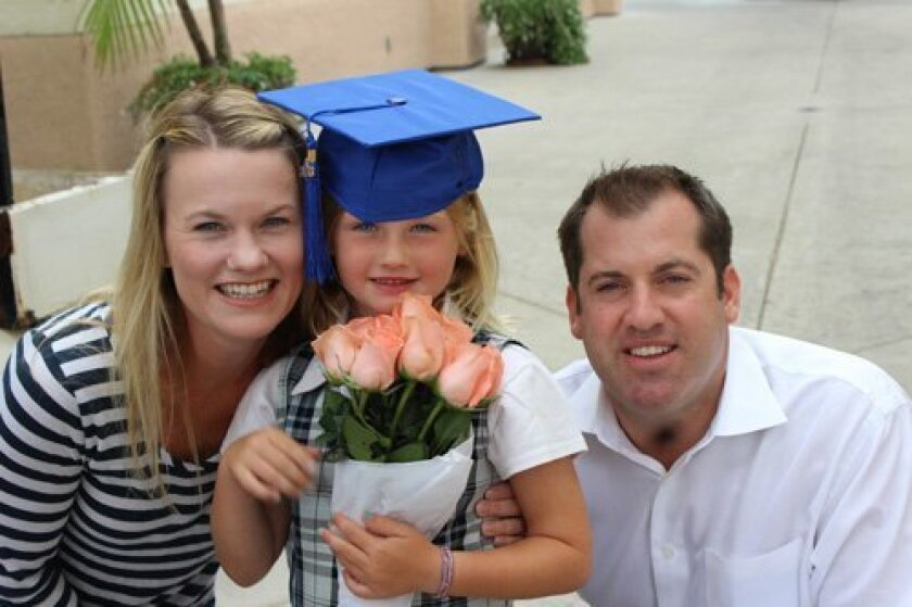 Graduate Clare Caster with her parents, Amy and David.