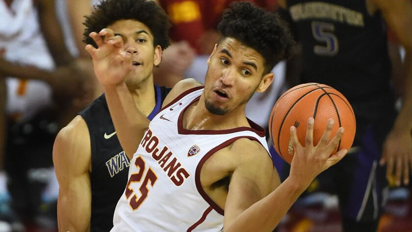 Bennie Boatwright, pulling down a rebound against Washington last season, returned to the USC lineup on Wednesday after missing nine months because of a knee injury.