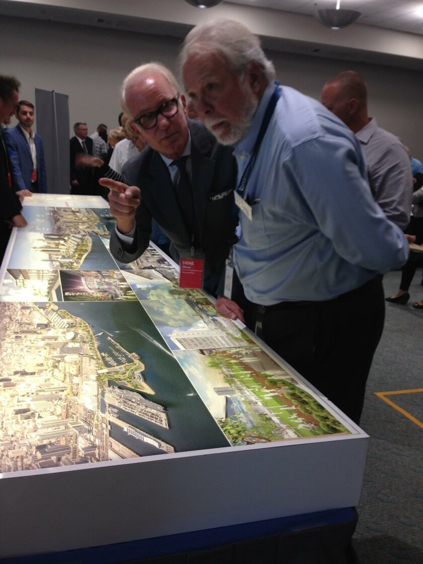 Developer Dene Oliver (left) and San Diego Port Commissioner Bob Nelson look over one of six proposals for the redevelopment of Seaport Village Monday.