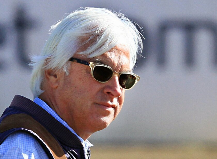 ADVANCE FOR WEEKEND EDITIONS, MAY 30-31 - FILE- In this May 14, 2015, file photo, trainer Bob Baffert watches his two Preakness Stakes entrants, American Pharoah and Dortmund, train at Pimlico Race Course in Baltimore. Wearing a cowboy hat and boots, Baffert had already conquered the quarter horse world and was ready to take aim at the bigger money and prestige offered by training thoroughbreds. It wasn't long before he piled up 11 wins in Triple Crown races and ditched his big hat but kept the boots. (AP Photo/Garry Jones, File)