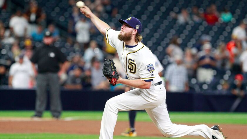 Padres' closer Brandon Maurer pitches to the Brewers in the ninth inning.