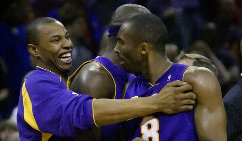 Kobe Bryant is congratulated by Caron Butler, left, and Jumaine Jones, center, after his game–winning basket in the Lakers' 117–116 win over the Charlotte Bobcats on March 12, 2005.