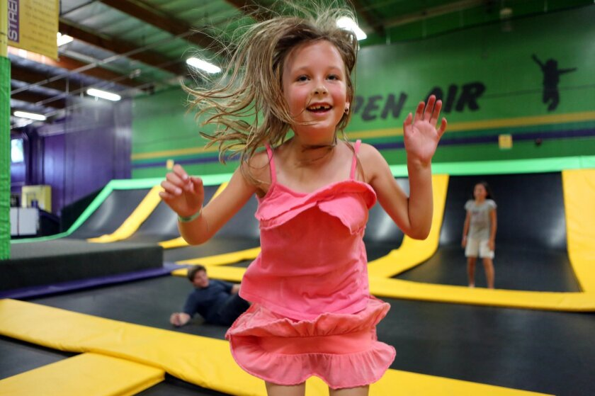 Danika Carpenter, 7, bounces on trampolines at Get Air trampoline park in Vista on Thursday.