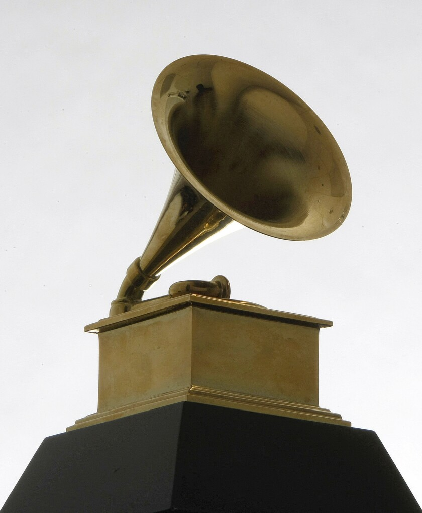 FILE - This Dec. 9, 2008 file photo shows a Grammy Award statue. The Recording Academy is making changes to several Grammy Awards categories, including the often-debated best new artist title, as well as having nomination review committee members sign disclosure forms to prevent conflicts of interest. The academy announced new rules Wednesday that will affect the 63rd annual Grammy Awards, which will air live on Jan. 31, 2021. (AP Photo/Charles Rex Arbogast, File)
