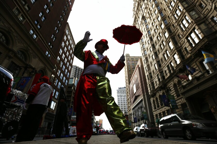 A mummer struts during the annual New Year's Day parade, Wednesday, Jan. 1, 2014, in Philadelphia. (AP Photo/Matt Rourke)