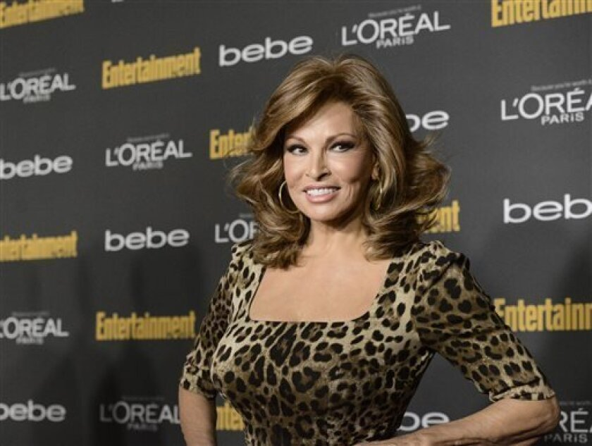 Actress Raquel Welch arrives at the 2013 Entertainment Weekly Pre-Emmy Party at Fig & Olive on Friday, Sept. 20, 2013 in Los Angeles. (Photo by Dan Steinberg/Invision/AP)