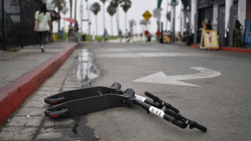VENICE, CA - July 25, 2018 Bird scooters are discarded near the Venice Beach Boardwalk in Venice on
