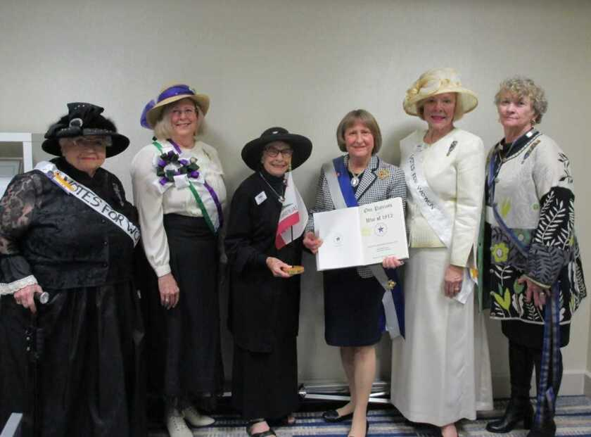 """The San Diego Chapter United States Daughters of 1812 gathered for the Annual USD1812 State Council at the Irvine Marriott. The group, including North County residents, celebrated Women's History Month and some members dressed in period attire from the suffragist movement. Martha Wheelock of Wild West Women presented a film titled 'California Women Win The Vote,' a compilation of stories of less-known women who were instrumental in the suffragist movement in California. Attendees included President-National, Mary Raye Casper and CA State President Jan Gordon. San Diego Chapter President, Wanda Prosser, presented Casper with a book titled, """"Our Patriots in the War of 1812"""" and a small California flag to go in the California Kitchen room at national Headquarters in Washington DC. The San Diego Chapter covers all of San Diego and Imperial Counties with some members in Orange County. From left, Donna Derrick, Jan Quigley, Wanda Prosser, Mary Raye Casper, Karon Jarrard and Joanne Murphy. Visit usd1812.org."""