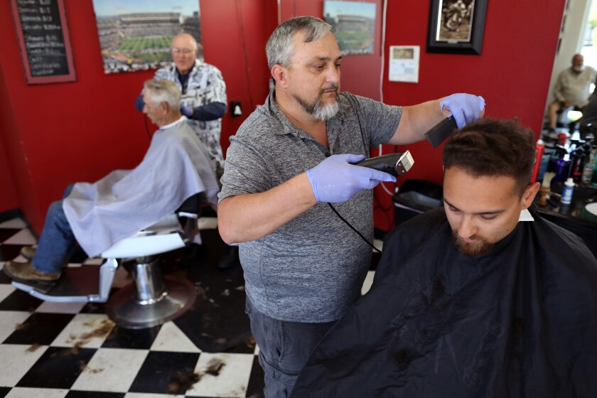 Wes Heryford, owner of Butte House Barber Shop in Yuba City, Calif., cuts hair.