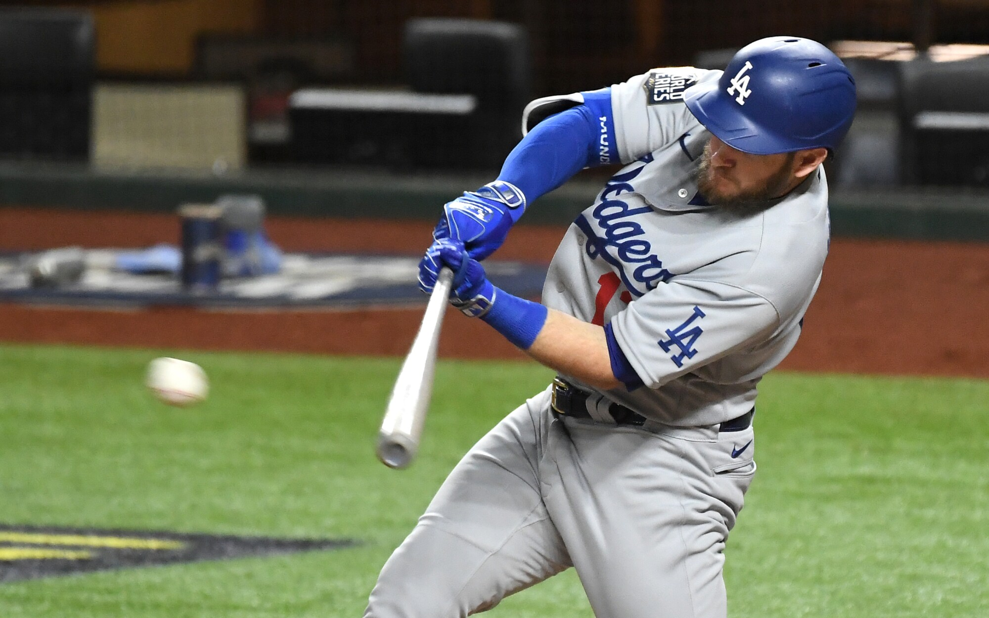 Dodgers first baseman Max Muncy hits a two-run single against the Rays.