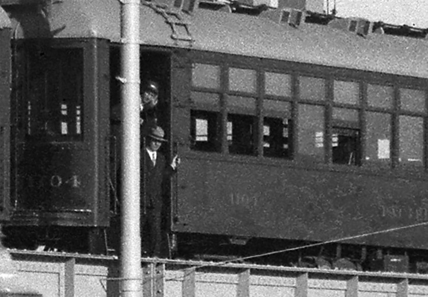 Man exits Pacific Electric Red Car train sitting on new viaduct in 1927