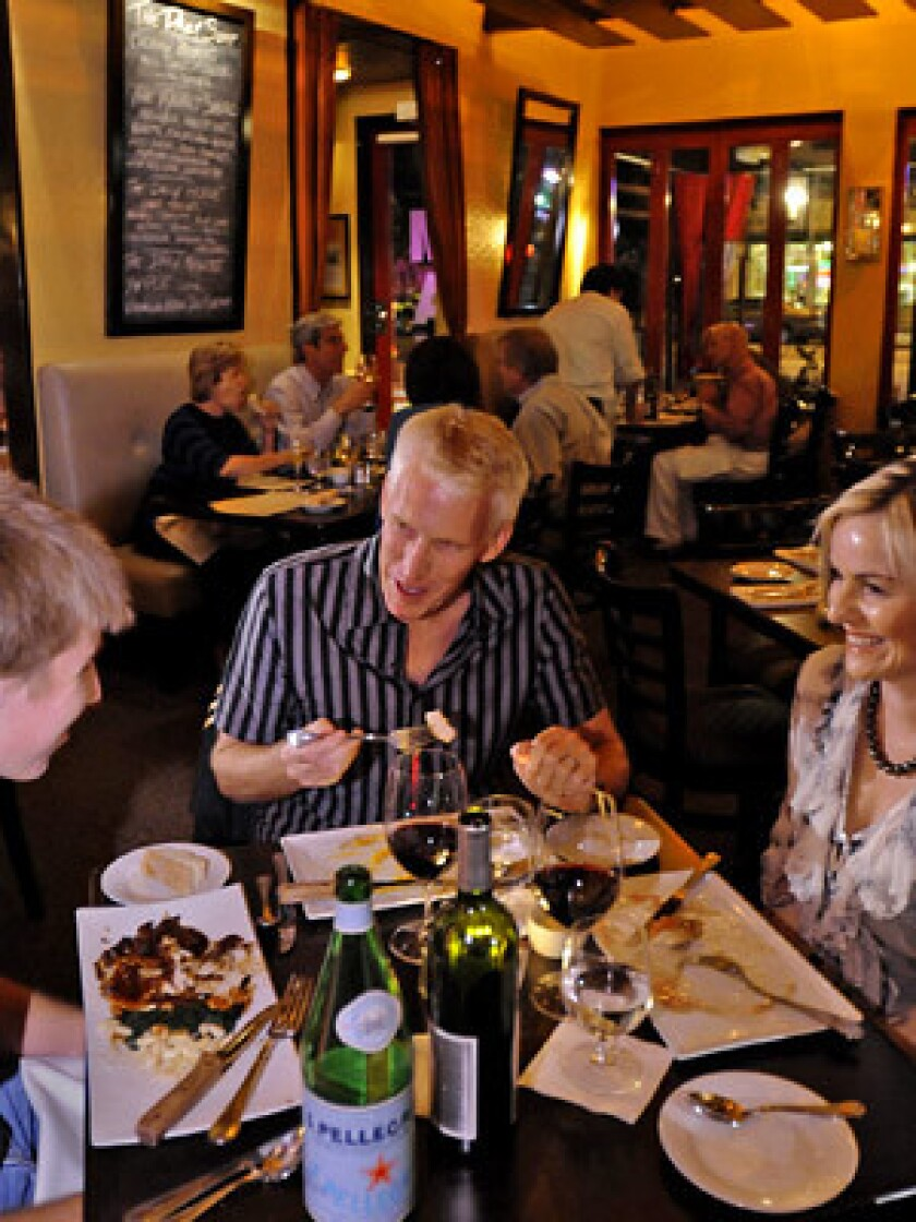 CASUAL MAKEOVER: Diners at Max savor the simple yet of-the-moment menu in a warm bistro atmosphere.