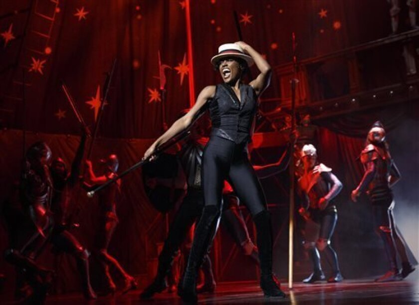 """FILE - This undated file image originally released by Boneau/Bryan-Brown shows Patina Miller during a performance of """"Pippin,"""" at Broadway's Music Box Theatre in New York. The production is directed by Diane Paulus. """"Pippin"""" is nominated for ten Tony Awards. (AP Photo/Boneau/Bryan-Brown, Joan Marcus)"""