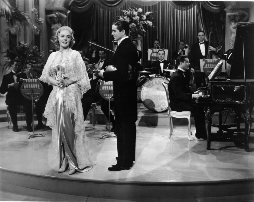 """Alice Faye and Tyrone Power in """"Alexander's Ragtime Band,"""" a musical featuring songs by composer Irving Berlin, 1938."""