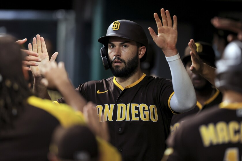 The Padres' Eric Hosmer celebrates with teammates after scoring a run during the second inning