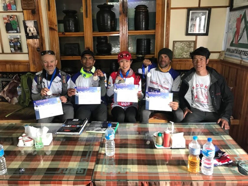 Vivian Lee, 48, of Encinitas is the first American woman to complete the Everest Extreme Ultra, a 60-kilometer foot race that begins at Mount Everest base camp in Nepal. Here, Lee, center, poses with three other Ultra finishers in Namche, Nepal, from left, Roberto Mello, Kapil Josh and Tony Briant, as well as her pacer/guide Bhim Raj Rai, right.