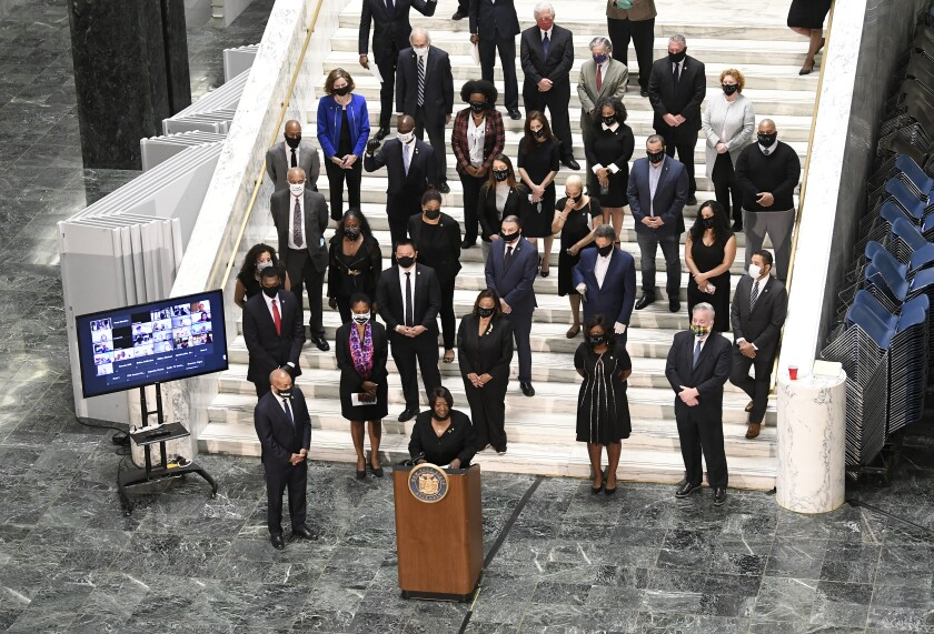 Assembly Majority Leader Crystal D. Peoples-Stokes, D- Buffalo, speaks in favor of new legislation for Police Reform while standing with Assembly members during a news briefing at the state Capitol Wednesday, June 8, 2020, in Albany, N.Y. New York lawmakers are poised to overhaul a decades-old law that has kept officers' disciplinary records secret. The Democrat-led Legislature planned to pass a repeal of the law Monday as part of a package of reforms that would also ban officers from subduing people with chokeholds. Gov. Andrew Cuomo said he intends to sign the legislation. (AP Photo/Hans Pennink)