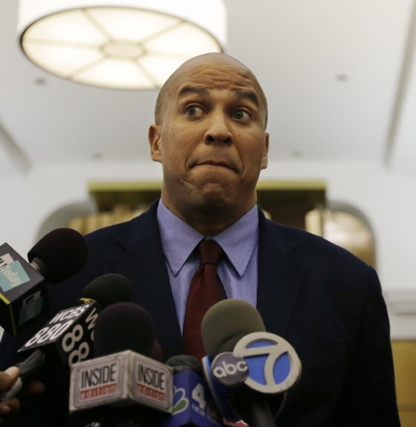 Newark Mayor and senate candidate Cory Booker listens to a question in Newark, N.J., Thursday, Sept. 26, 2013. Booker says the disclosure that he messaged with a stripper isn't going to change anything about how he uses Twitter.