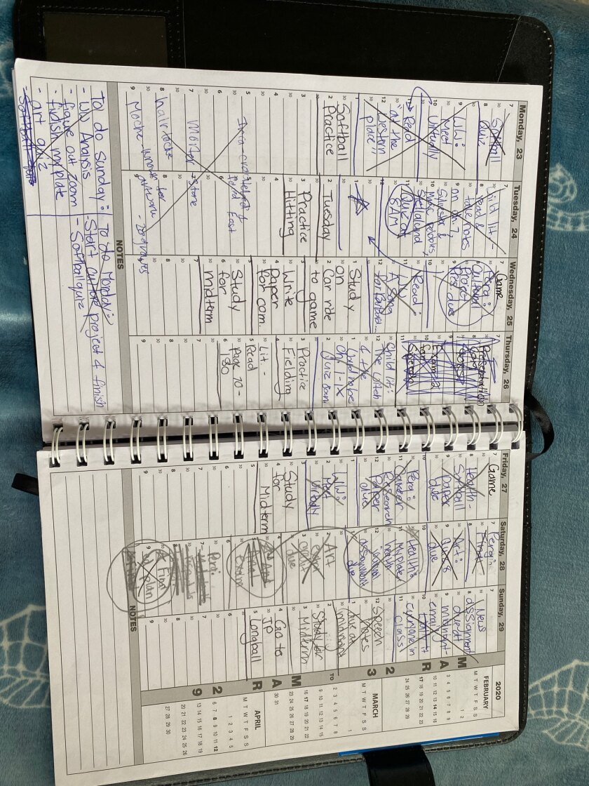 Savannah Ames' planner is full to keep track of her 24 units and softball events.