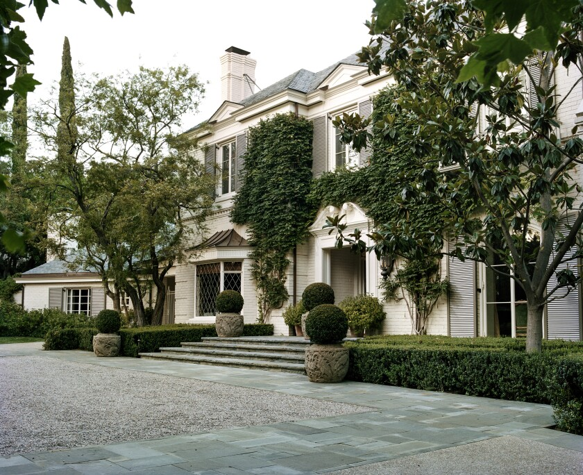 The Holmby Hills estate, once owned by vaudeville star Fanny Price, was expanded and renovated by architect Oscar Shamamian. Set behind gates, the Georgian Traditional-style mansion features detailed crown moldings, coved ceilings and hand-carved fireplaces. Listed for $62 million, the estate includes a swimming pool and pool pavilion, an outdoor kitchen, a tennis court and a three-car garage on two acres.
