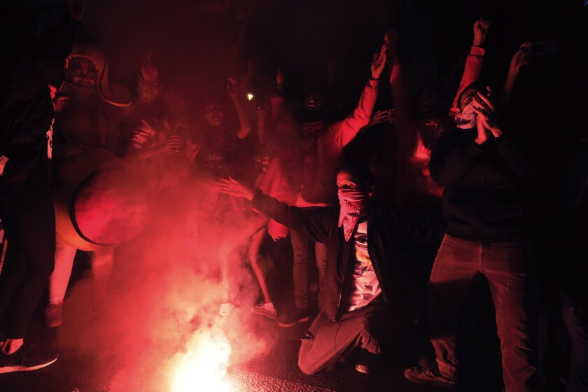 Israeli protesters chant slogans during a demonstration against Israeli Prime Minister Benjamin Netanyahu in Jerusalem, Saturday, Dec. 12, 2020. (AP Photo/Sebastian Scheiner)