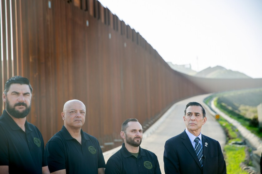 Former Congressman Darrell Issa, a candidate for the 50th Congressional District, speaks alongside members of the National Border Patrol Council as he receives the group's endorsement Thursday.