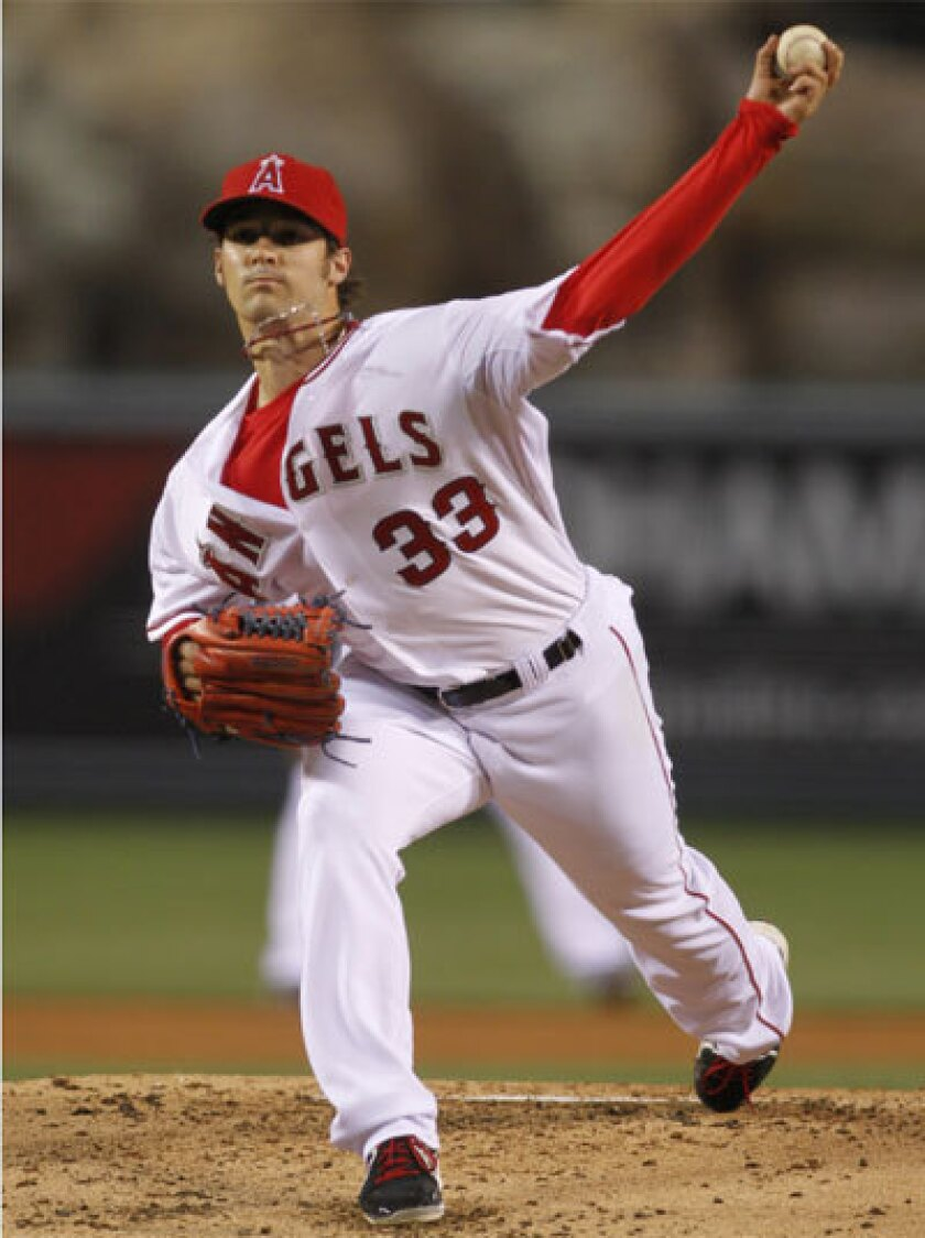 Angels pitcher C.J. Wilson gave up a three-run double to Seattle's Justin Smoak in the third inning of an 8-3 loss Tuesday night.