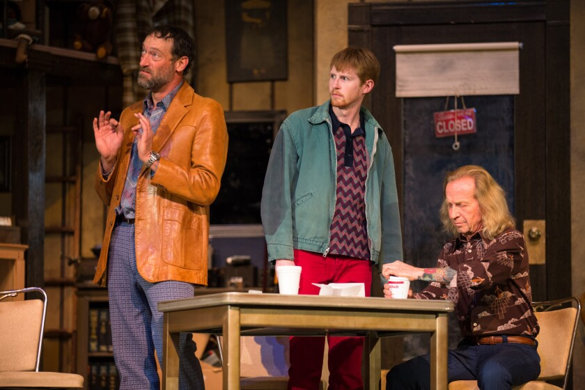 """Teacher (Troy Kotsur), left, Bobby (Matthew Ryan Pest) and Donny (Paul Raci) plot to steal a rare coin in the Deaf West and Cal State L.A. production of """"American Buffalo,"""" performed in a mixture of American Sign Language and spoken English."""