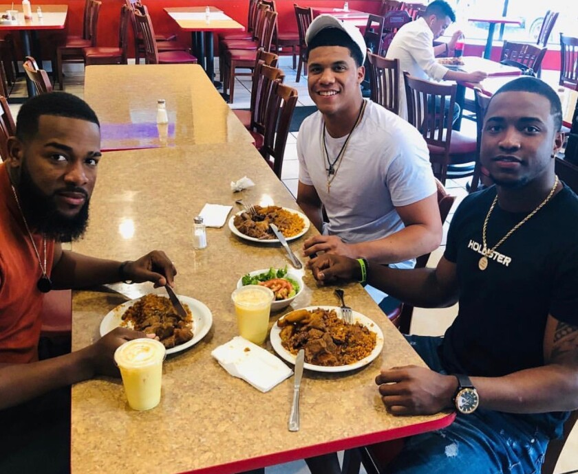 From left, the Nationals' Wander Suero, Juan Soto and Victor Robles eat at Los Hermanos in Washington, D.C.