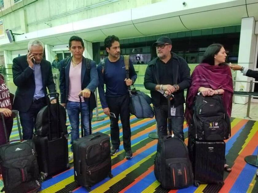 Photo sent from Univision on Feb. 26, 2019, in Venezuela showing the journalist Jorge Ramos (L) at the Maiqueta airport in Venezuela being deported by Venezuela after an interview with Nicolas Maduro. EPA- EFE/UNIVISION/EDITORIAL USE ONLY