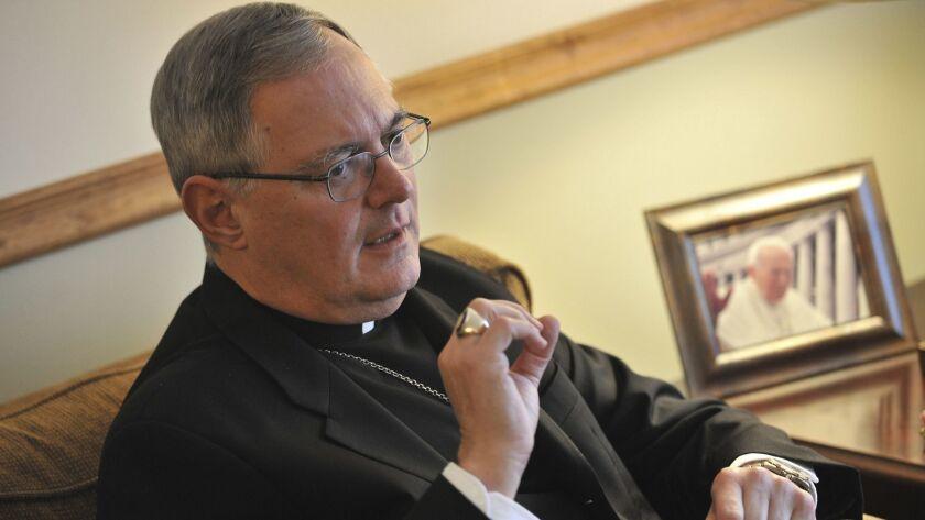 FILE - In this Nov. 22, 2009 file photo, Roman Catholic Bishop Thomas Tobin speaks to a reporter in
