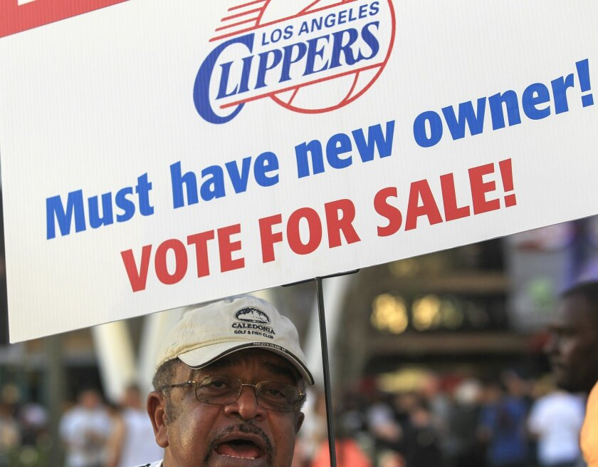 Sam Wright protests against Los Angeles Clippers owner Donald Sterling, outside Staples Center before Game 5 of the Clippers' opening-round NBA basketball playoff series against the Golden State Warriors on Tuesday, April 29, 2014, in Los Angeles. NBA Commissioner Adam Silver announced Tuesday that Sterling has been banned for life by the league for making racist comments that hurt the league. (AP Photo/Ringo H.W. Chiu)