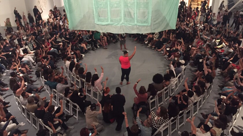 """""""Raise your hand if you're ready to show up for black lives like never before,"""" Black Lives Matter co-founder Patrisse Cullors instructed the audience."""