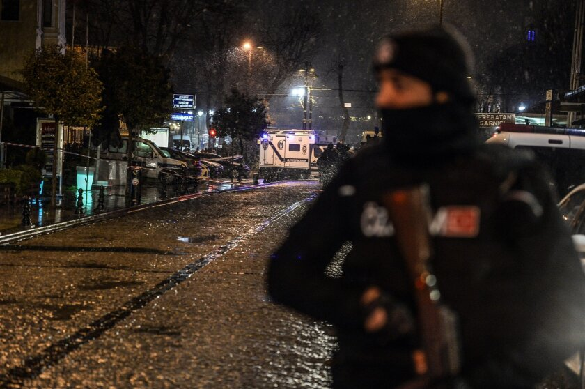 A Turkish police officer stands guard near a police station where a woman detonated a suicide bomb Jan. 6 in Istanbul's main tourist district of Sultanahmet.