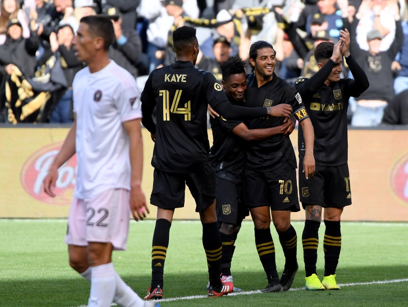 LAFC forward Carlos Vela (10) gathers with his teammates after scoring during the team's 1-0 season-opening victory over Inter Miami at Banc of California Stadium on Sunday.
